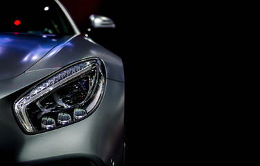 Wall Mural - Detail on one of the LED headlights super car for copy space