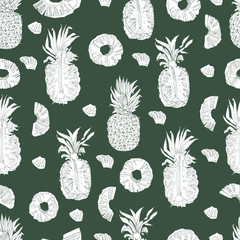 Seamless pattern  with inverted  white  pineapple fruits. Whole and sliced elements isolated on dark green background. Hand drawn sketch