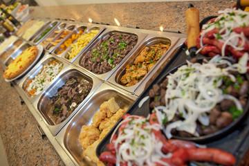 Varied types of food in self service restaurant platters