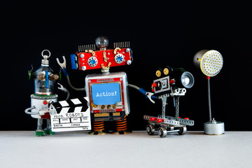 Robotic filmmaker cameraman, assistant with clapperboard behind the scene motion picture Robots. Automated video film production concept. Success of robotic scientific technology and artificial