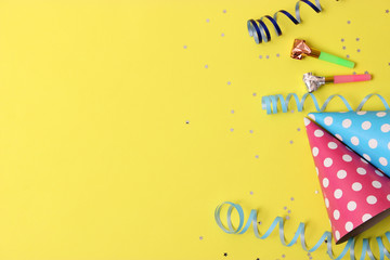 Accessories for a party or birthday on a colored background top view. Wall mural