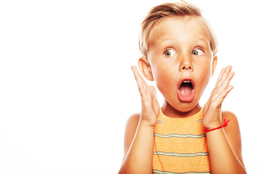 Oh, my God, Can't believe it, School Gossip concept. Portrait of shocked cute little boy in orange sleeveless T-shirt isolated on white background. Close up. Copy-space. Studio shot
