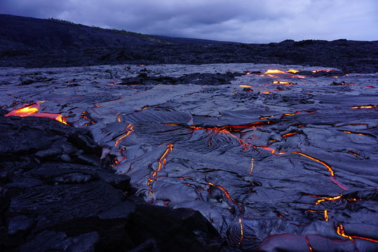 Lava field with new hot flowing lava in Big Island in Hawaii
