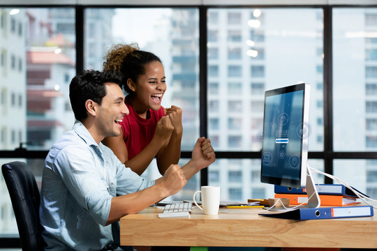 New generation businessmen feeling happy in front of computer in  office. Since online sales system is able to work efficiently on a 5G network system. Causing sales to meet the target.