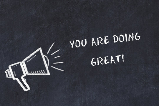 Chalk board sketch with loudspeaker and motivational phrase you are doing great