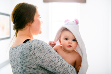A mother and baby in a bath aving fun