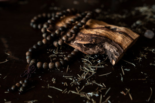 Brown wooden rosary praying buddhist beads with a piece of palo Santo wood