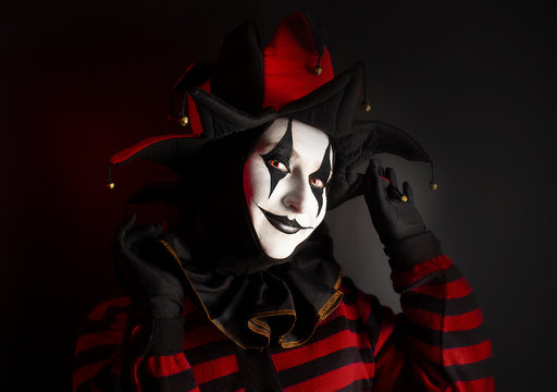 Beautiful playful smiling jester woman, close-up.