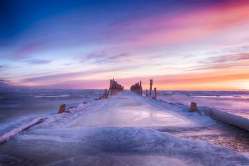 Garden Poster Winter seascape of wood breakwaters on frozen Baltic sea