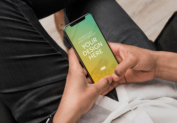 Person using Smartphone on Sofa Mockup