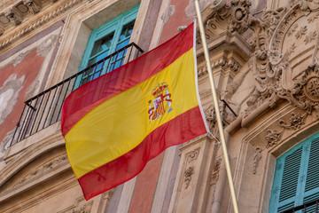 Waving spanish flag on building