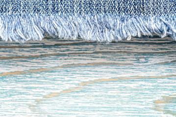 Denim texture on blue wooden background, border