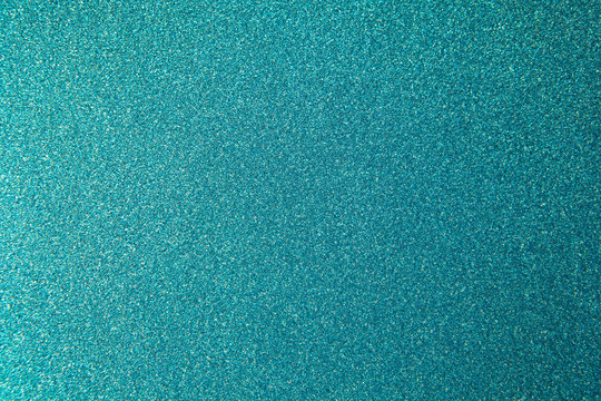 Metallic glitter green-blue aquamarine wrapping paper backgrond, close-up. Copy space for text. Horizontal and vertical. Celebration, holidays, sales, fashion concept, harvesting for mock up.