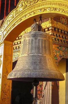 Giant prayer bell at Boudhanath stupa, Kathmmandu, Nepal