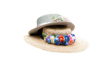 Two woman hats with colorful fabric flowers isolated on white
