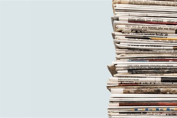 Pile of newspapers on white background Wall mural