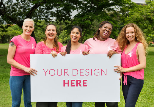 5 People in Pink Holding a Sign Mockup