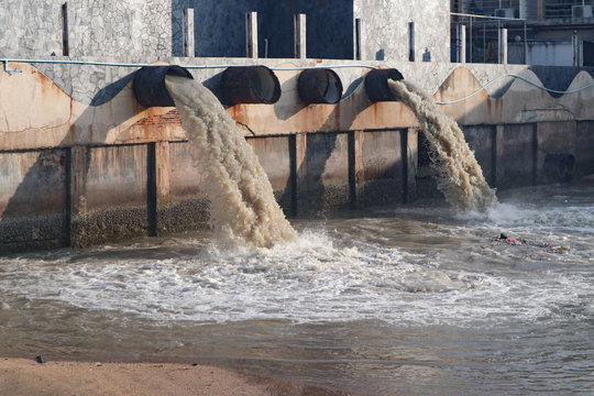 Industrial and factory waste water discharge pipe into the canal and sea, dirty water pollution