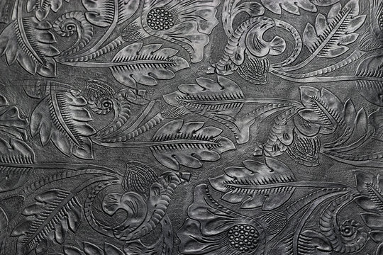 Embossed shiny black leather with the floral motif
