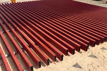 Metal and alumunium pipes heap in the cargo warehouse for transportation to the factory