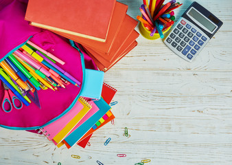 Stationery with copyspace. On the table scattered a bright stationery