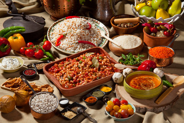 Traditional tableware made of dried beans, rice, soup, various spices, vegetables and fruits, uncooked raw pulses