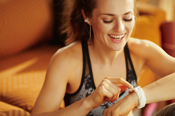 sports woman using smart watch to track weight in fitness app