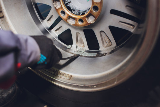 Wheel weights for balancing tires arrayed in trays for precise balance.