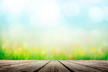 Wall Mural - Background with sunny meadow over wooden deck