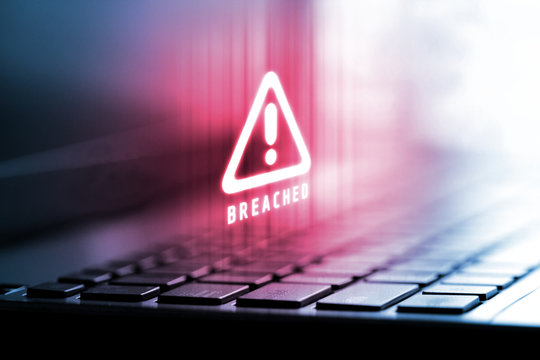 3D Rendering of alert logo on laptop computer. Concept of privacy data being hacked and breached from internet technology threat. For personal privacy, Cryptocurrency token security.