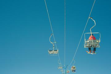 Ski lift on the slop in mountain ski resort