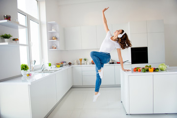 Wall Mural - Full length body size view of her she nice-looking attractive strong cheerful cheery wavy-haired girl having fun hand on table raising up in modern light white interior style room