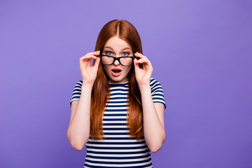 Portrait of her she nice-looking attractive charming cute lovely winsome confused youngster lady looking putting glasses off isolated over bright vivid shine violet background
