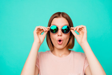 Close up photo beautiful funny funky her she lady hold hands arms dark sunglass look flying airplane first time wonderful sight wear casual pastel t-shirt clothes isolated teal turquoise background