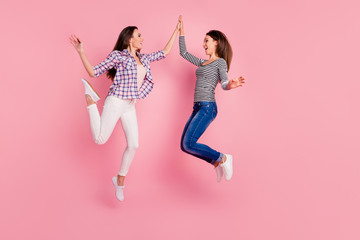 Profile side view full length body size photo of excited energetic teens teenagers enjoying laughing wearing checked shirts jeans having stroll screaming isolated on pink background
