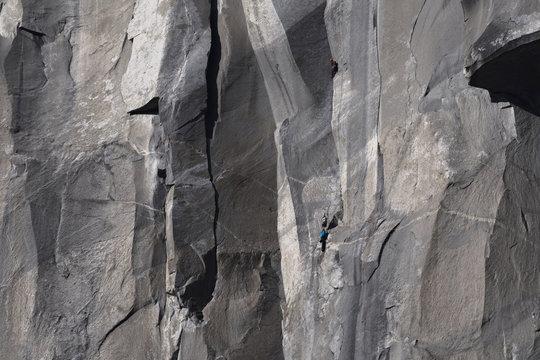 Climbers attempt to climb jagged granite of El Capitan in Yosemite National Park