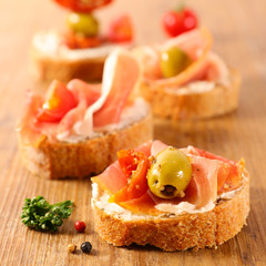 tapas, canape with cheese and ham
