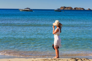 Young trendy woman relax on the beach.