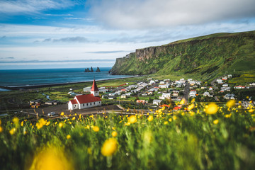 Beautiful town of Vik i Myrdal in Iceland in summer. The village of Vik  is the southernmost village in Iceland on the ring road around 180 km southeast of Reykjavík. Fototapete