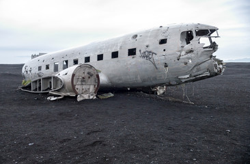 Wreckage of crashed airplane Dakota United States Navy Douglas Super DC-3 on the coast of iceland black sand beach. Solheimasandur, Iceland