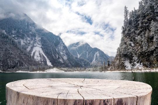 Stump table on Winter Mountain Landscape.