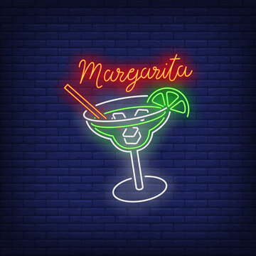 Margarita neon text, drink glass, straw, ice cubes and lime
