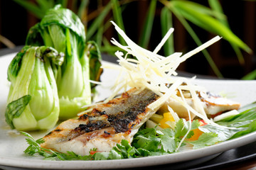 Grilled sea bass fillet with ginger, fresh peppers and pak choy / Fusion food