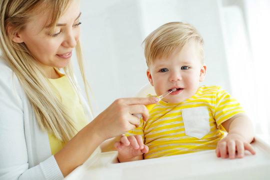 Mom baby brushing teeth
