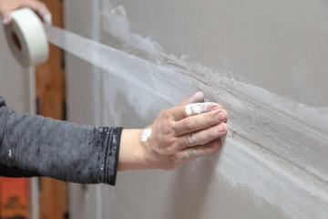 Tape for plaster on the wall. Repair in the house