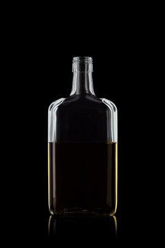 Bottle of whiskey rectangular shape, isolated on a black background with reflections. 100 sharpness.