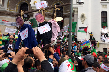 People protest to push for the removal of the current political structure in Algiers