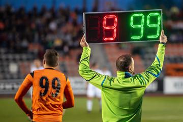 Fototapeta Referee shows players substitution . obraz