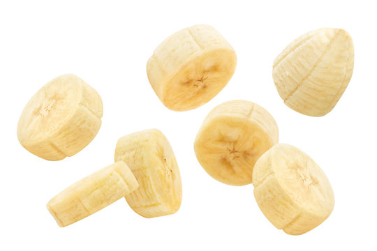 Flying banana slices, isolated on white background