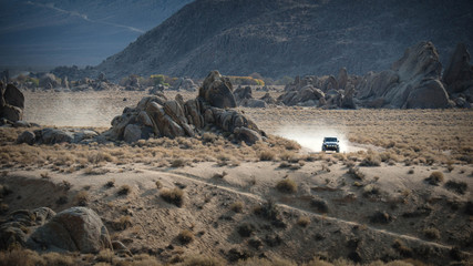 4x4 vehicle driving in the desert, Alabama Hills, California, United states